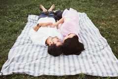 Happy and young pregnant couple. In the park Stock Photography