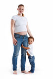 Happy young pregnant mother with her son. Stock Photo