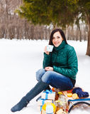Happy young pregnant woman having fun in the winter park Stock Photos