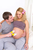 Happy young pregnant woman and her Royalty Free Stock Photo