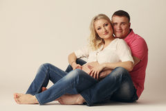 Happy young pregnant woman with her husband Royalty Free Stock Photos