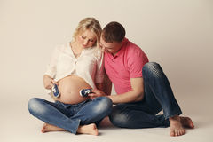 Happy young pregnant woman with her husband Stock Images