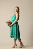 Happy young pregnant woman holding flowers Royalty Free Stock Images