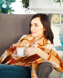 Happy young pregnant woman near the Christmas tree siting in arm Stock Photography