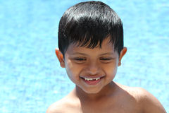 Happy young preschool kid(boy) enjoying his time in a swimming p Stock Photo