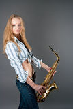 Happy young pretty blonde girl with sax Stock Images