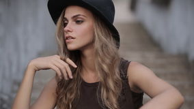 Happy young pretty girl in black hat stock video