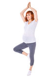 Happy young pretty pregnant woman doing yoga isolated on white Royalty Free Stock Photo