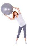 Happy young pretty pregnant woman with fitball isolated on white Stock Image