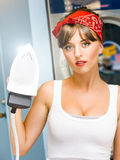 Happy Young Pretty Woman Ironing Stock Photos