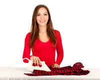 Happy young pretty woman ironing clothes Royalty Free Stock Photos