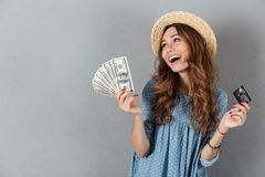 Happy young pretty woman standing over grey wall Royalty Free Stock Photos