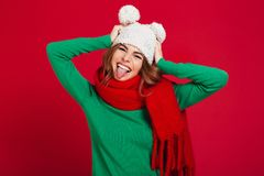 Happy young pretty woman wearing hat and warm scarf royalty free stock photography