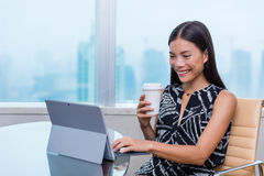 Happy young professional on laptop drinking coffee Royalty Free Stock Photo