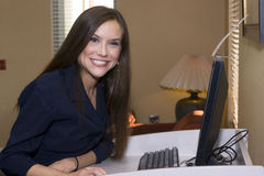 Happy young female hotel receptionist Royalty Free Stock Image