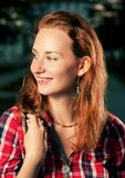 Happy young red haired women smiling outdoors Royalty Free Stock Images
