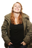 Happy young redhead woman in parka Stock Images
