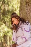 Happy young retired woman. In the mountains a young retired woman is makink a call with mobile phone and happy she breathes deeply enjoying the holidays stock photo