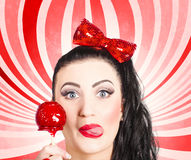 Happy young retro woman with lollipop toffee apple Royalty Free Stock Photo