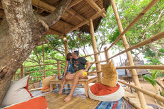 Happy Young Romantic caucasian Couple in gazebo on the tree, tropical Bali island, Indonesia.. Vacation Honeymoon Royalty Free Stock Images