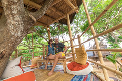 Happy Young Romantic caucasian Couple in gazebo on the tree, tropical Bali island, Indonesia.. Vacation Honeymoon Stock Photo