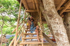 Happy Young Romantic caucasian Couple in gazebo on the tree, tropical Bali island, Indonesia.. Vacation Honeymoon Royalty Free Stock Photography