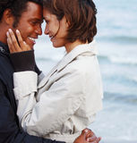 Happy young romantic couple face to face Stock Photos