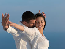 Happy young romantic couple have fun arelax  relax at home. Happy young romantic couple have fun relax smile at modern home outdoor terace balcony terace Stock Images