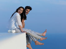 Happy young romantic couple have fun arelax  relax at home. Happy young romantic couple have fun relax smile at modern home outdoor terace balcony terace Royalty Free Stock Photo