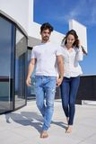 Happy young romantic couple have fun arelax relax at home. Happy young romantic couple have fun relax smile at modern home outdoor terace balcony terace royalty free stock image