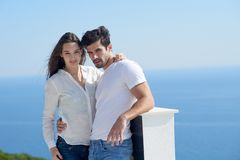 Happy young romantic couple have fun arelax relax at home. Happy young romantic couple have fun relax smile at modern home outdoor terace balcony terace royalty free stock images