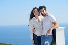 Happy young romantic couple have fun arelax relax at home. Happy young romantic couple have fun relax smile at modern home outdoor terace balcony terace royalty free stock photos