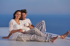 Happy young romantic couple have fun arelax relax at home. Happy young romantic couple have fun relax smile at modern home outdoor terace balcony terace stock photos