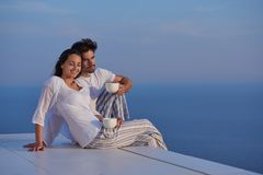 Happy young romantic couple have fun arelax relax at home. Happy young romantic couple have fun relax smile at modern home outdoor terace balcony terace royalty free stock photography