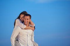 Happy young romantic couple have fun arelax relax at home. Happy young romantic couple have fun relax smile at modern home outdoor terace balcony terace stock photo