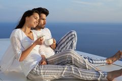 Happy young romantic couple have fun and relax at home. Happy young romantic couple have fun relax smile at modern home outdoor terace balcony royalty free stock photo