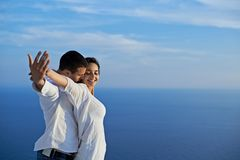Happy young romantic couple have fun and relax at home. Happy young romantic couple have fun relax smile at modern home outdoor terace balcony royalty free stock photography