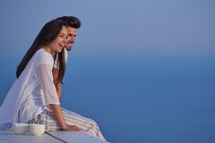 Happy young romantic couple have fun and relax at home. Happy young romantic couple have fun relax smile at modern home outdoor terace balcony stock images
