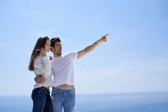 Happy young romantic couple have fun and relax at home. Happy young romantic couple have fun relax smile at modern home outdoor terace balcony royalty free stock images
