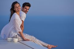 Happy young romantic couple have fun and relax at home. Happy young romantic couple have fun relax smile at modern home outdoor terace balcony stock photography