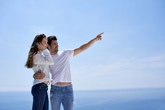 Happy young romantic couple have fun and relax at home. Happy young romantic couple have fun relax smile at modern home outdoor terace balcony stock photos