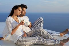 Happy young romantic couple have fun and relax at home. Happy young romantic couple have fun relax smile at modern home outdoor terace balcony royalty free stock image