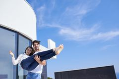 Happy young romantic couple have fun relax at home. Happy young romantic couple have fun relax smile at modern home outdoor terace balcony terace stock photography