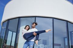 Happy young romantic couple have fun relax at home. Happy young romantic couple have fun relax smile at modern home outdoor terace balcony terace royalty free stock images