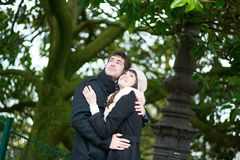 Happy romantic couple hugging in park Stock Photos