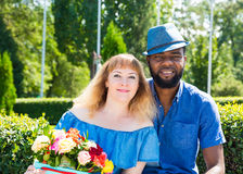 Happy young romantic couple in love. Black man and white woman. Love story and people`s attitudes. Beautiful marriage concept. Royalty Free Stock Images