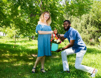 Happy young romantic couple in love. Black man and white woman. Love story and people`s attitudes. Beautiful marriage concept. Stock Image