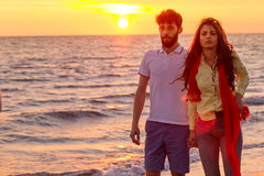 Happy young romantic couple in love have fun on beautiful beach at beautiful summer day Stock Image