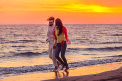 Happy young romantic couple in love have fun on beautiful beach at beautiful summer day.  Stock Photos
