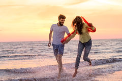 Happy young romantic couple in love have fun on beautiful beach at beautiful summer day.  Stock Photography